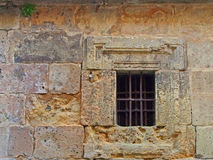 iron-bars-old-window-set-very-decayed-eroded-sandstone-wall-54150201